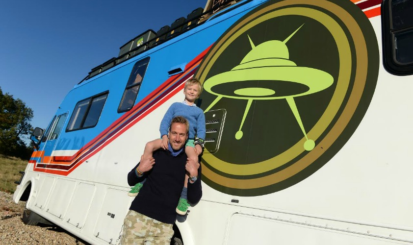 EDITORIAL USE ONLY Television presenter Ben Fogle and his son Ludo, aged 6, launch Cartoon NetworkÕs Rust Bucket competition in partnership with Airbnb, for families to win a nightÕs stay in a real-life replica of the motorhome that features in the animated series Ben 10, which returns to screens on Saturday 8th October at 10am. PRESS ASSOCIATION Photo. Issue date: Wednesday October 5, 2016. The real-life Rust Bucket will be available exclusively on Airbnb during the October half term at Rendlesham Forest in Suffolk, which is the UKÕs most prominent UFO hotspot. Photo credit should read: Doug Peters/PA Wire
